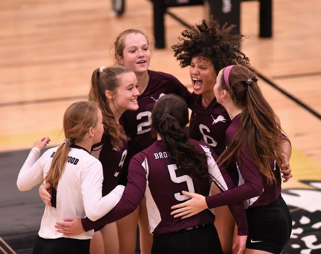 Brownwood celebrates winning a point against Abilene High at Eagle Gym on Tuesday. The Lady Lions pulled out a 23-25, 25-18, 30-28, 22-25, 15-8 victory in the five-set thriller.
