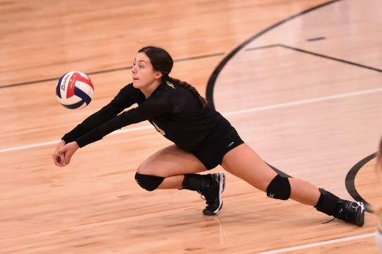 Abilene High libero Maddie Perez (3) dives for the ball against Brownwood on Tuesday. Perez had 44 digs in the match as the Lady Eagles fell in a five-set battle.