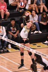 Abilene High's Sarah Cox (11) goes up for the kill against Brownwood at Eagle Gym on Tuesday, Aug. 27, 2019. The Lady Eagles fell in a five-set battle.