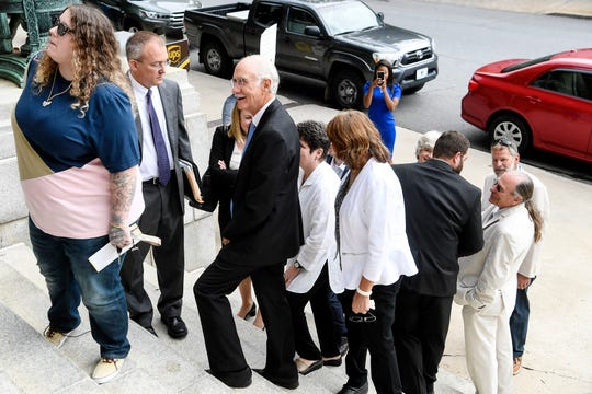 Former assistant county manager Jon Creighton on Aug. 28, 2019, waits in line to enter the federal courthouse in downtown Asheville, where he ultimately is sentenced to 18 months in prison for participating in a yearslong bribery scheme with a contractor.