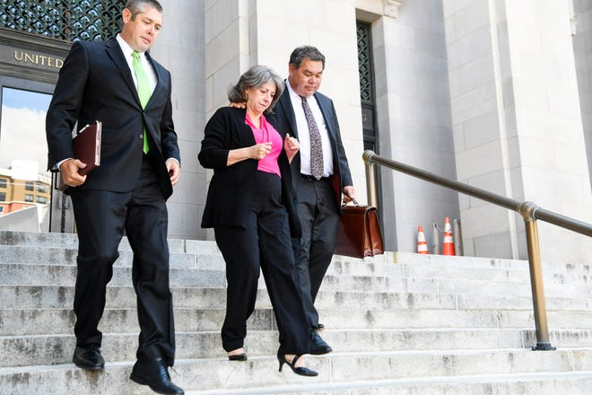 Wanda Greene leaves the federal courthouse after being sentenced to 7 years in prison and ordered to pay a $1000,000 fine August 28, 2019 in Asheville.