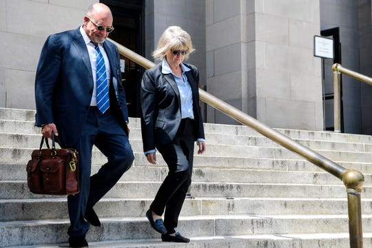 Mandy Stone leaves the federal courthouse after being sentenced to 33 months in prison and ordered to pay a $15,000 fine August 28, 2019 in Asheville.