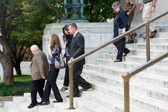Michael Greene, former Buncombe County business intelligence manager and Wanda Greene's son, exits the federal courthouse in downtown Asheville after being sentenced to six months in jail. The 48-year-old, along with his mother, used county-issued credit cards for thousands of dollars in personal purchases.