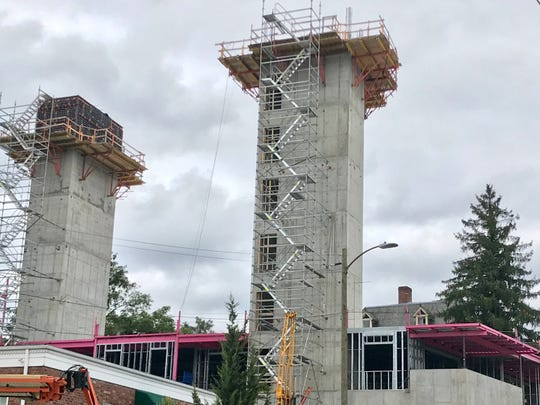 The new 145 Biltmore condominium project boasts bright pink structural steel, part of an upcoming Breast Cancer Awareness month fundraiser. The eight-story building should be complete by summer 2020.
