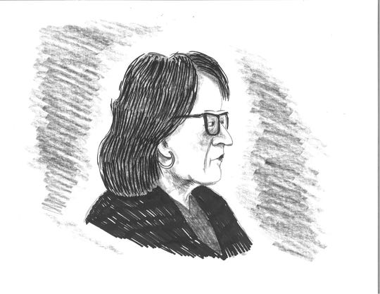 Former county manager Wanda Greene appears in court for sentencing in a Buncombe County corruption case Aug. 28, 2019, in this illustration by David Cohen. Green was sentenced to 84 months in federal prison and was fined $100,000.