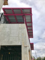 The new 145 Biltmore condominium project boasts bright pink structural steel, part of an upcoming Breast Cancer Awareness month fundraiser. The 8-story building should be complete in summer 2020.