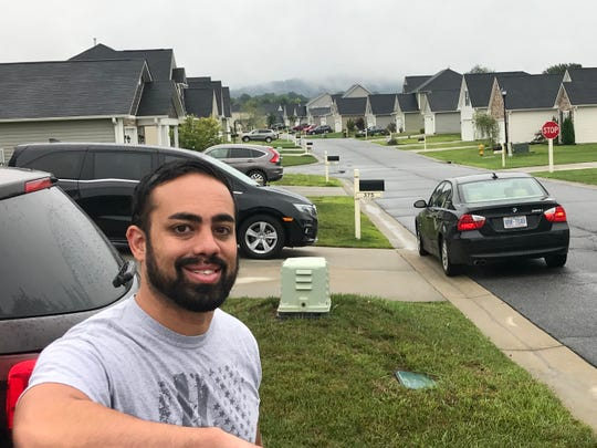 Justin Lentini and his wife used to live in Asheville, but they found the Riverstone neighborhood in northern Henderson County much more affordable.