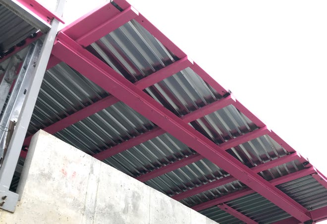 The new 145 Biltmore condominium project boasts bright pink structural steel, part of an upcoming Breast Cancer Awareness month fundraiser.