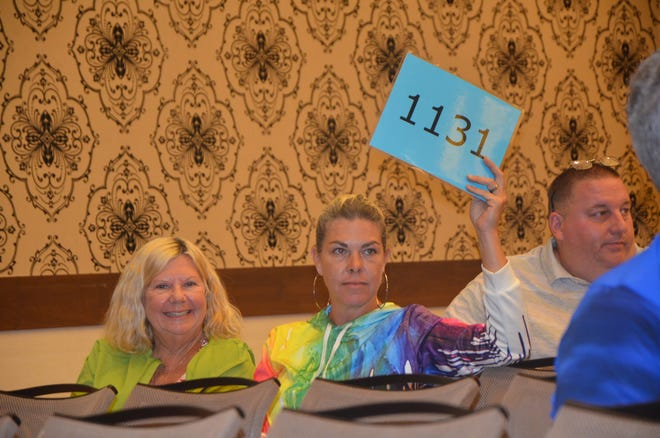 Over 100 foreclosed properties were sold on site at Firekeepers Casino on Tuesday.