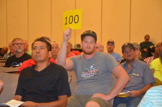 Hundreds of people attended this year's Calhoun County foreclosed properties auction at Firekeepers Casino on Tuesday.