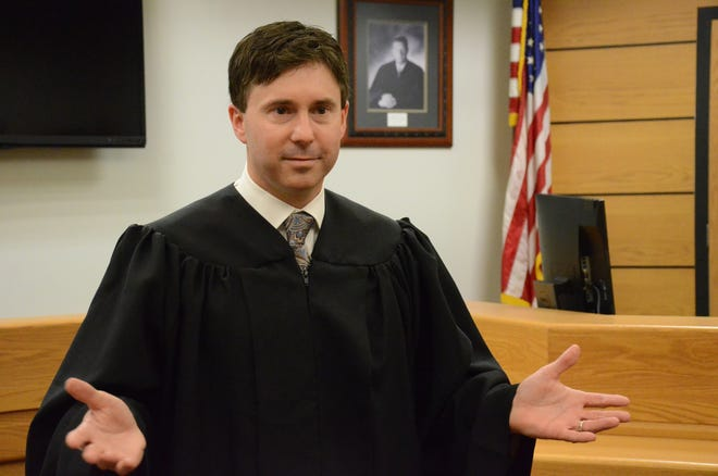 Jason Bomia speaks after he was sworn in Wednesday as District Court judge.