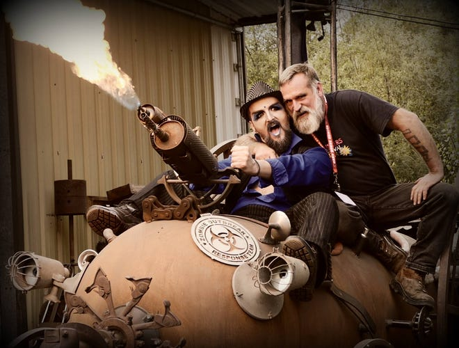 """Elton Busby, also known as Poppy, left, and Michael Kerkes, right, ride a zombie-fighting """"steam-punk mobile"""" created by local artist Ray Hammar. Hammar's studio is the staging ground for the Gorst Underground Film Festival."""