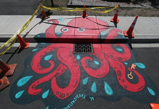 "Jacquelyn Speare's ""Giant Octopus"" adorns the curb, road and sidewalk. The ground mural was commissioned by Kitsap County Public Works' stormwater division along with others on Keyport streets."