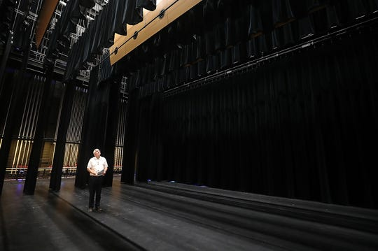 Doug Newell, Central Kitsap School District assistant superintendent, moves across the stage while giving a tour of the auditorium at the new Central Kitsap High School in Silverdale.