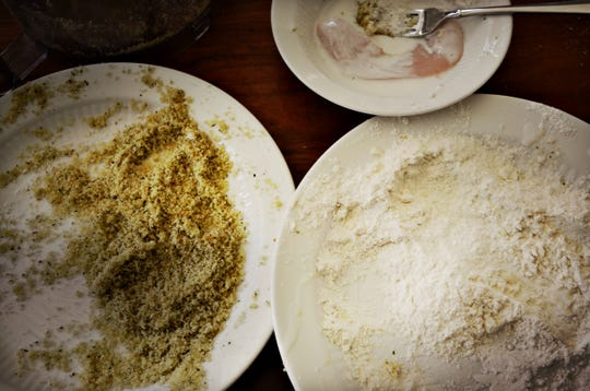 The four-step breading process starts with buttermilk, then flour, then buttermilk again, then oiled bread crumbs.