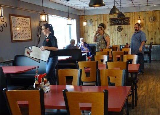 Diners head for a table on Tuesday afternoon  at the Rusty Horseshoe in Galion. The new restaurant had its grand opening on Wednesday.