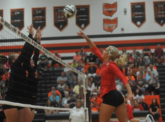 Buckeye Central's Alivia Niese tips a ball over the Seneca East defense at the net.