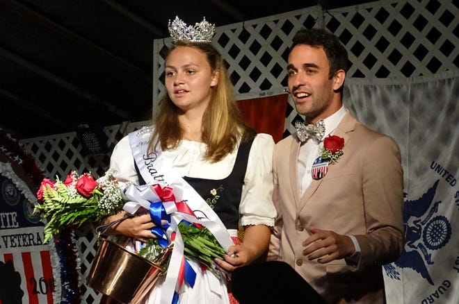 Emcee Matthew Allen Meade stands next to newly crowned Bratwurst Festival Queen Sarah Beck at conclusion of the 2019 queen's pageant on Aug. 15.