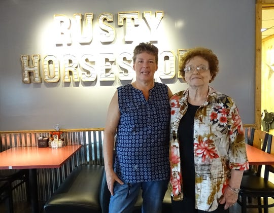 Rusty Horseshoe owner Debbi Bachelder stands with her mother, Noni Wheeler, in the Galion restaurant's dining room on Tuesday.