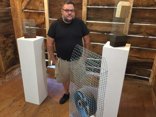 Ric Kasini Kadour, curator of contemporary art at the Rokeby Museum in Ferrisburgh, stands at the museum among sculptures by Middlesex artist Axel Stohlberg on Aug. 27, 2019.