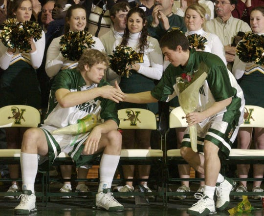 Taylor Coppenrath, left, and T.J. Sorrentine will have their jerseys -- No. 22 and No. 11 -- officially retired by the UVM men's basketball team on Oct. 26 during an exhibition vs. Brown. Sorrentine is the associate head coach at Brown.
