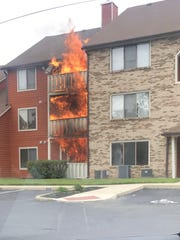 Flames shoot up all three floors of a 20-unit condominium building in Brittany Lakes in Mount Laurel before firemen arrive Tuesday aternoon. Several units suffered serious damage and others smoke and water damage the fire, which remains under investigation.
