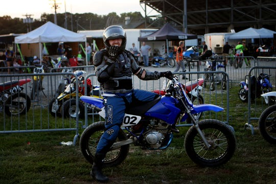Enquirer entertainment editor, Rasputin Todd, poses for a photo as he waits in the pen to take a practice lap around Lawrenceburg Motorcycle Speedway on Friday, August 16. Motorcycle racing is held almost every Friday evening weather permitting, through October. All ages and levels of expertise are welcome