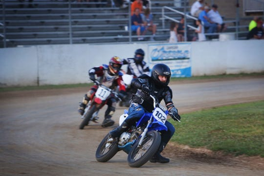 Enquirer entertainment editor, Rasputin Todd (#102) competes in his first 'mad dog' division race at the Lawrenceburg Motorcycle Speedway's flat dirt track on Friday, August 16. Motorcycle racing is held almost every Friday evening weather permitting, through October. All ages and levels of expertise are welcome