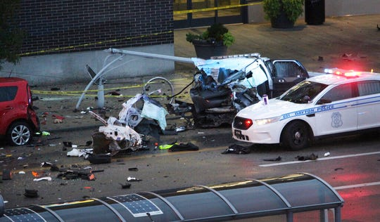 Dayton police work the scene of a crash on East Third Street involving a stolen Riverside police SUV in Dayton, Ohio, Tuesday, Aug. 27, 2019. Authorities in Dayton, say a suspect in a stabbing stole the police SUV and crashed it into a van filled with children, killing two 6-year-old girls.