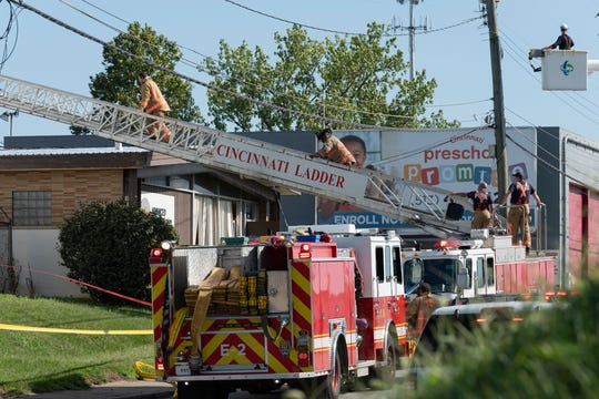 Firefighters respond to a building collapse at 4900 Para Drive in Bond Hill neighborhood of Cincinnati, Ohio on Wednesday, Aug. 28, 2019.
