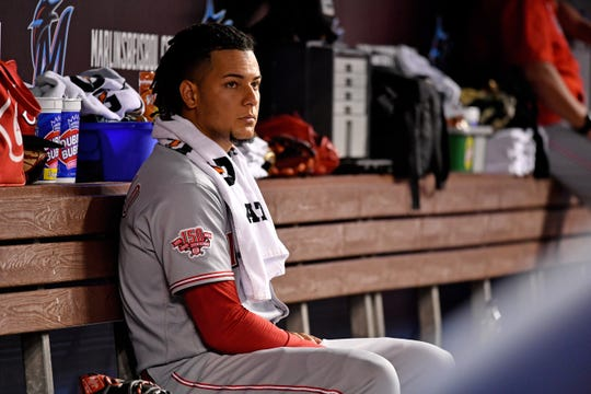 Aug 27, 2019; Miami, FL, USA; Cincinnati Reds starting pitcher Luis Castillo (58) looks on from the dugout between innings against the Miami Marlins at Marlins Park.
