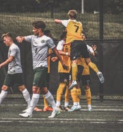 NKU players celebrate a goal in a preseason friendly against Tiffin University Aug. 25.