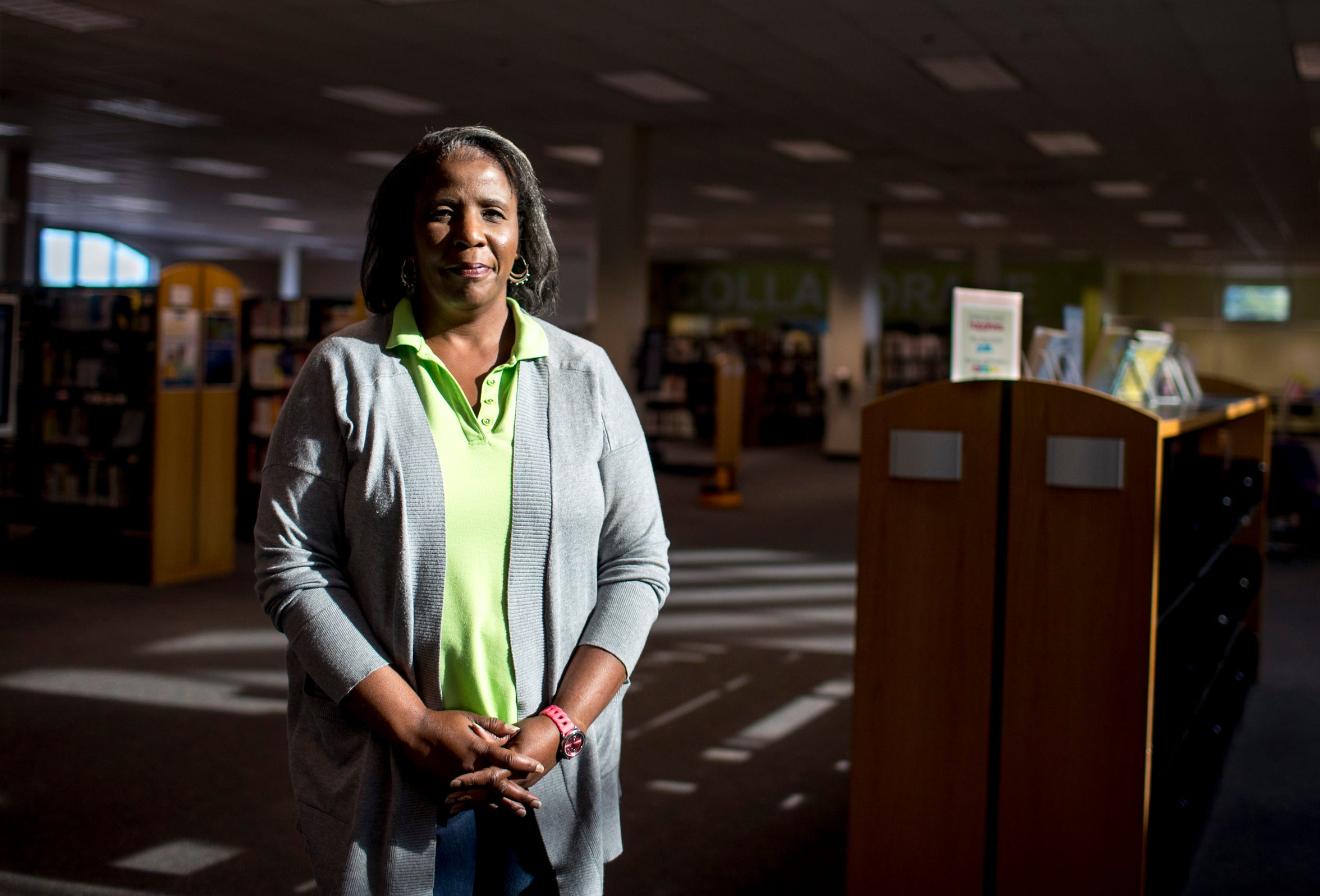 Technical services supervisor Jackie Warfield, a librarian who curates material, stands in the Montgomery County Public Library in Clarksville on Saturday, Aug. 17, 2019.