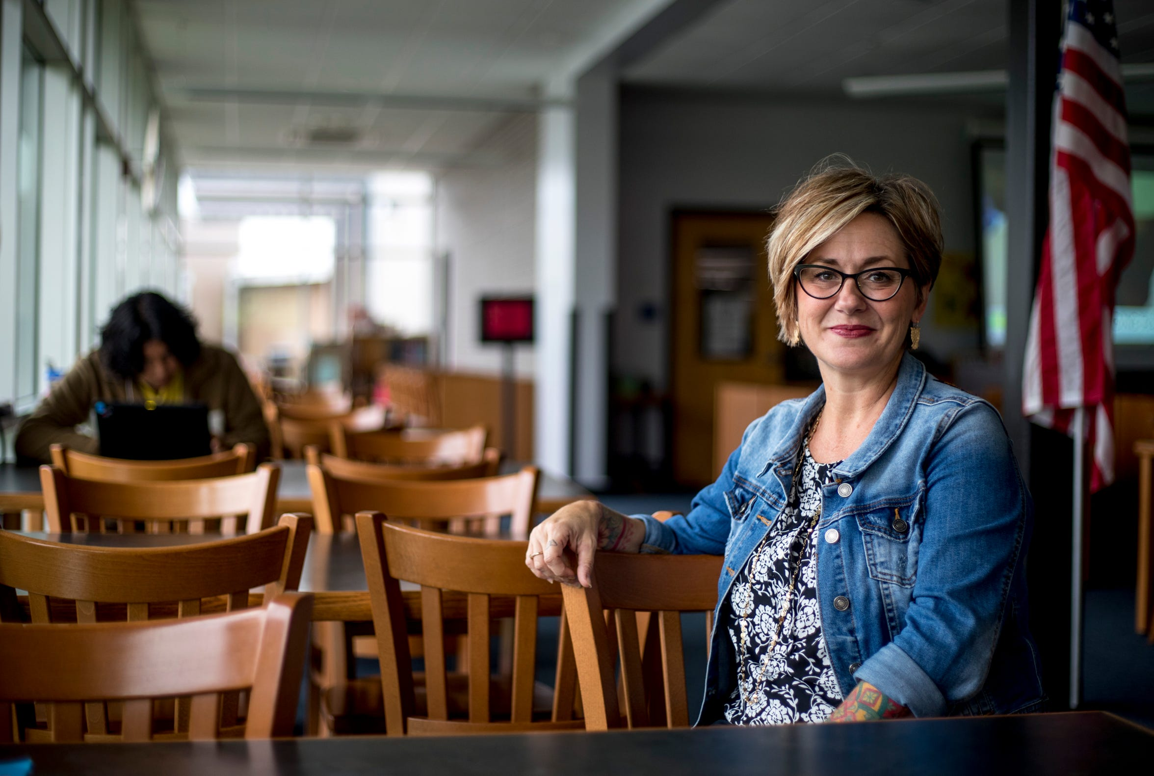 Melanie Hazen, who teaches AP literature and poetry and serves as school librarian at Montgomery Central High School, sits in the library on Monday, Aug. 26, 2019.