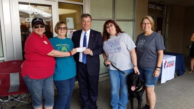 Shown from left are Stacey Colie Hopwood, Barbara Sokol, Sen. Bill Powers, Shawnette Murphy, and Maureen Martin Hiemstra.