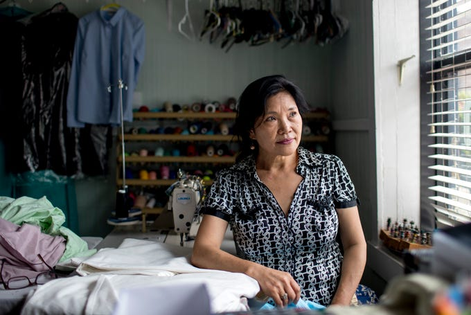 Mae Magee, who has owned her own tailor shop for nearly 20 years and what used to be a dry cleaner next door, sits at her work station where she does all her sewing at Mae's Tailor Shop in Clarksville, Tenn., on Tuesday, Aug. 27, 2019.