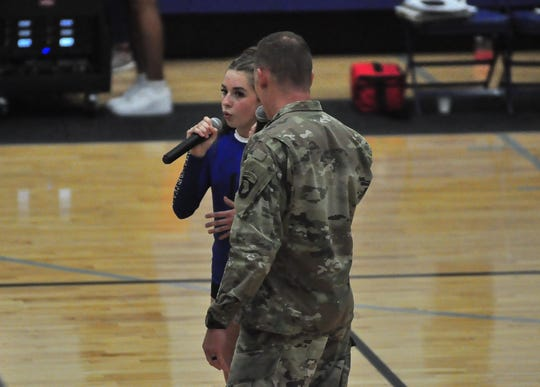 Fort Campbell High School sophomore Reagan Peterson sings the National Anthem with her father, Army Chaplain Paul Peterson, before the school's first home volleyball game of the season on Aug. 26, 2019.