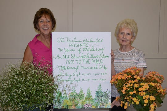 "Neshanic Garden Club Co-Chairmen Diana Reinhardt and Jean Stives show off a poster advertising the ""90 Years of Gardening"" Standard Flower Show which will be held on Friday, Sept. 13 from 1 to 7 p.m. and Saturday, Sept. 14 from 10 a.m. to 3 p.m. The show is free to the public on both days and will be held at the Hillsborough Municipal Building at 379 South Branch Road in Hillsborough. Judging will take place on the morning of Friday, Sept. 13, so when you arrive, you will see ribbons of many colors already in place when the show opens its doors. The club is celebrating its 90th anniversary this year. For further information, contact Diana at 908-369-4362 or Jean at 908-359-6480."