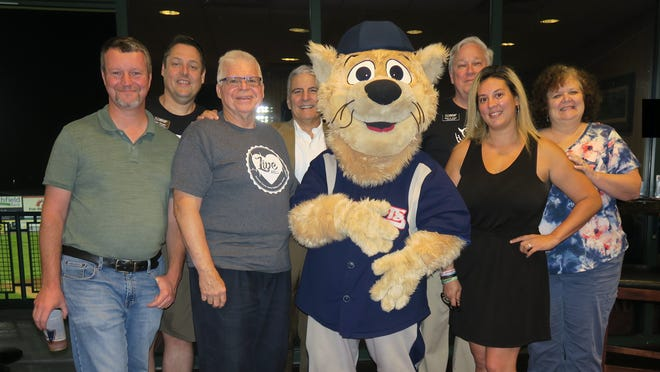 (Left to right) Rich Loomis, SCLSNJ digital services manager; Brian Morgan, SCLSNJ director of finance; Ken Utter, library commission vice chairman; Anthony Suriano, library commission chairman; Slider, Somerset Patriots mascot; Brian Auger, county library administrator; Catherine Heldt, library commissioner; and Nancy Stoll, library commissioner.