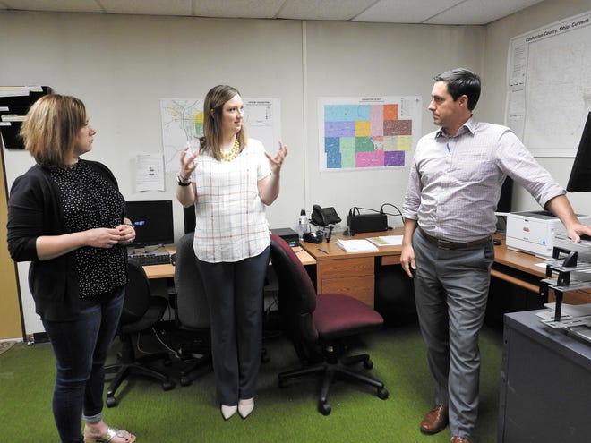 Deputy Director Kirsten Ross and Director Stephanie Slifko of the Coshocton County Board of Elections talk with Secretary of State Frank LaRose during a recent visit to the local office. The stop included an office tour and discussion of new voting machines, election security and engaging younger voters.