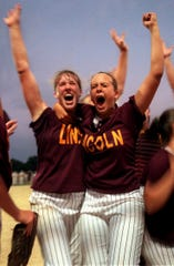 Lisa Birocci and Sara Evans celebrate Lincoln High School's berth in the Class 3-A softball tournament berth in 1998.
