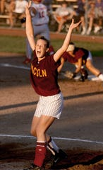 Lisa Birocci celebrates the last in a 1-0 over North Scott for the Lincoln's second state softball title in 2001.