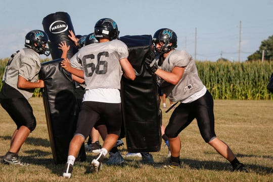 Southeast Valley sophomore Aaron Graves (right) runs a drill in practice in Gowrie on Tuesday, Aug. 27, 2019.
