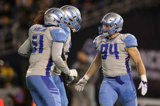 In this March 9, 2019, file photo, Salt Lake Stallions defensive end Karter Schult (94) celebrates his sack with Stallions Greer Martini (51) and another teammate in the first half of an AAF football game in San Diego. Schult, who played at the University of Northern Iowa, is currently with the Minnesota Vikings, the fourth NFL team that has had him on the roster.