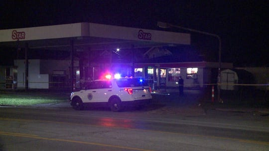 Police investigate a shooting Wednesday morning at the Star gas station on Ingersoll Avenue in Des Moines.