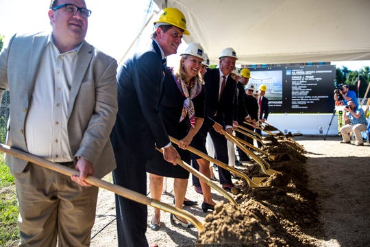 Officials involved with the constriction of the new federal courthouse for the Southern District of Iowa ceremonially break ground on Wednesday, Aug. 28, 2019, in downtown Des Moines.