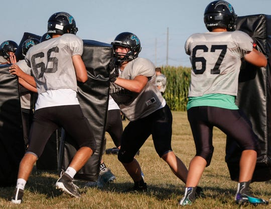 Southeast Valley sophomore Aaron Graves (center) runs a drill in practice in Gowrie on Tuesday, Aug. 27, 2019.