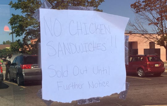 A sign on the door at Popeye's on Woodward in Detroit.