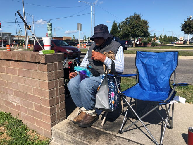 Francis Sawicki, 67, sits in the parking lot of the Royal Oak Walgreens where his belongings were stolen two weeks earlier.