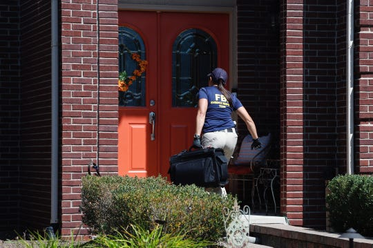 FBI Detroit office special agent Mara Schneider walks into Gary JonesÕ home in Canton on Wednesday, August 28, 2019.